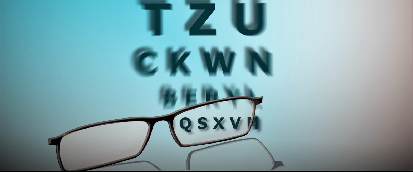 An image of alphabets getting blur, the below alphabets getting focuse