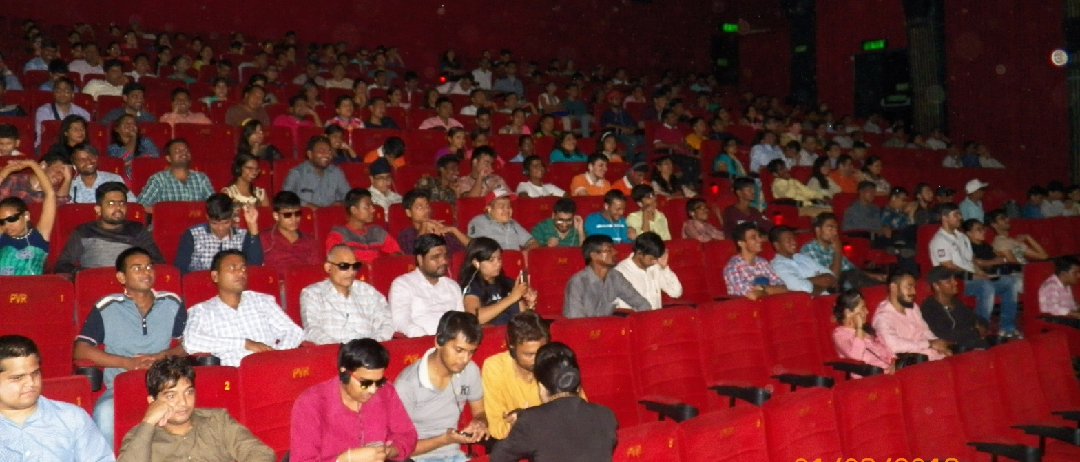 A movie hall full of visually impaired and sighted people.