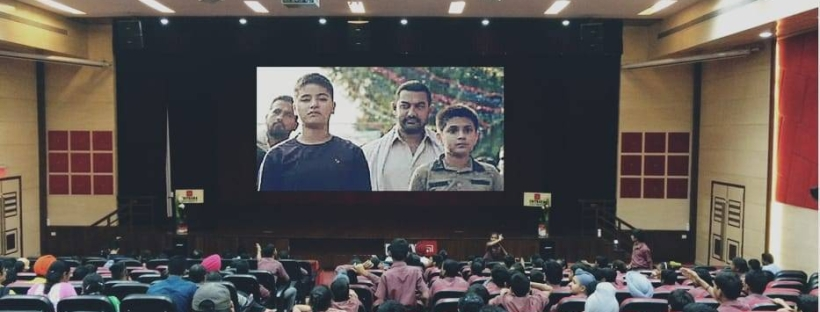 Visually Impaired Children watching Audio Described Version of Dangal